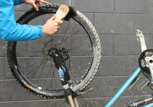 Apply a genral bike cleaner then lather up with your brush