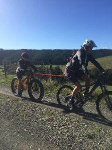 Riding towing kid up to Spooners Tunnel