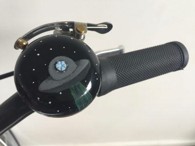 Hand painted bicycle bell on handlebar. goRide